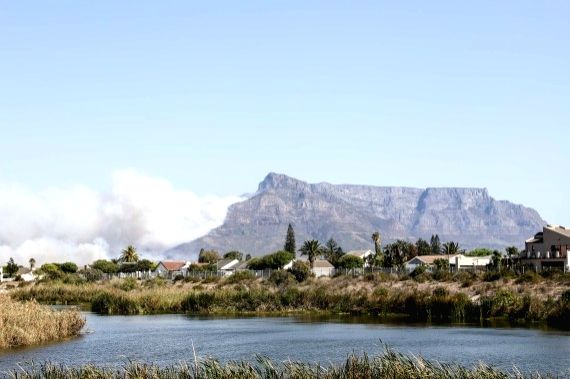 Heavy smoke rises from Table Mountain in Cape Town, South Africa, on April 18, 2021.
