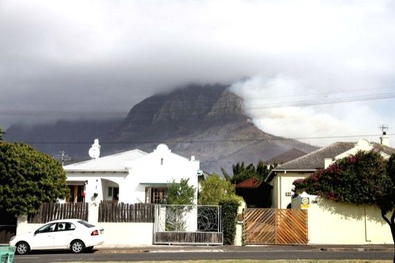 Heavy smoke rises from the Table Mountain in Cape Town, South Africa, on April 19, 2021.
