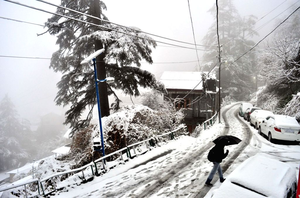 Heavy snowfall wraps Shimla's landscape in snow on Feb 12, 2018. Snowfall left Himachal Pradesh's capital Shimla and its nearby tourist destinations a picturesque look. Shimla recorded a ...