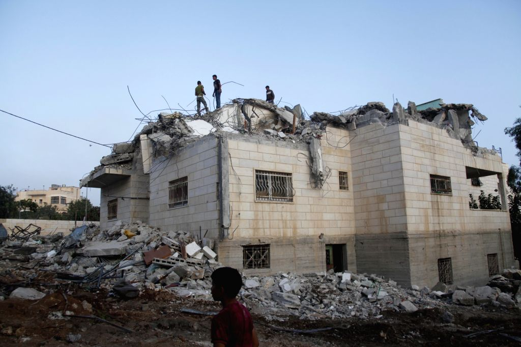 HEBRON, Aug. 4, 2016 - People inspect the family house of Palestinian Mohammad Makhamreh after it was demolished by an Israeli army bulldozer in the West Bank village of Yatta, south of Hebron, on ...