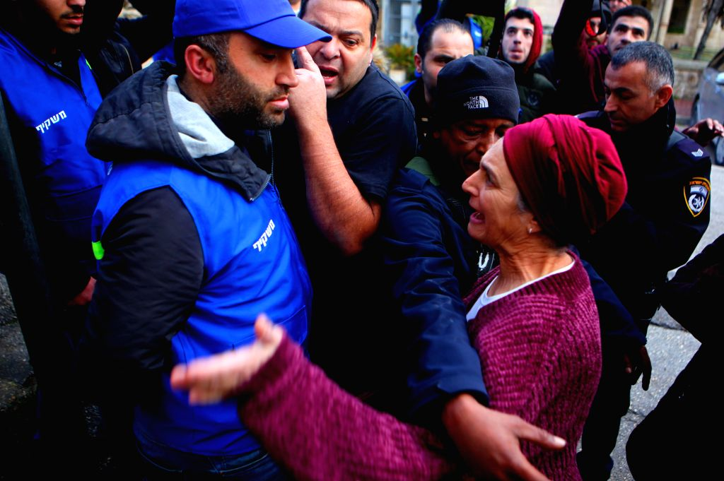 HEBRON, Feb. 10, 2019 - A Jewish settler shouts at Palestinian activists (in blue) during a protest in the West Bank City of Hebron, on Feb. 10, 2019. Palestinian activists on Sunday launched a ...