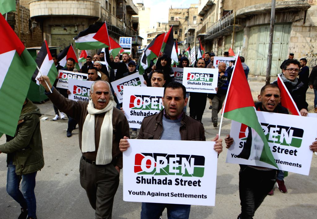 HEBRON, Feb. 22, 2019 - Palestinian take part in a protest calling for opening Shuhada street to Palestinians in the West Bank city of Hebron, Feb. 22, 2019.