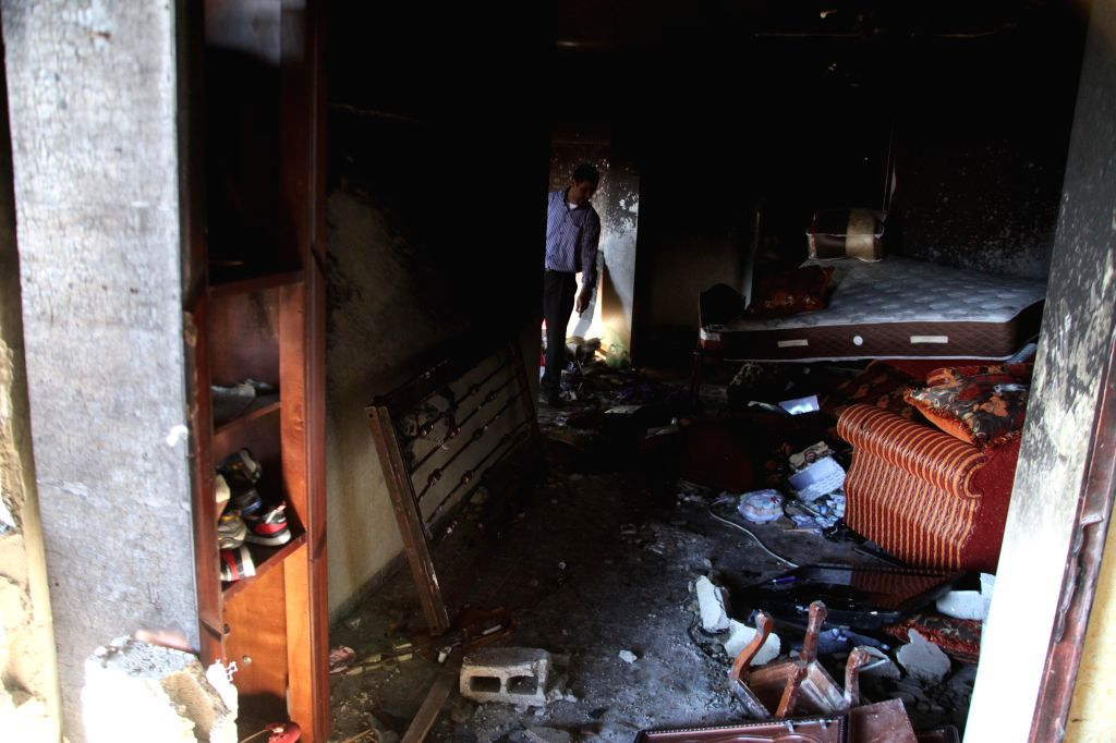 Palestinians inspect the house of Amer Abu Eishe, a member of the Islamist Hamas in Hebron named by Israel as one of the two prime suspects in the murder of three ...