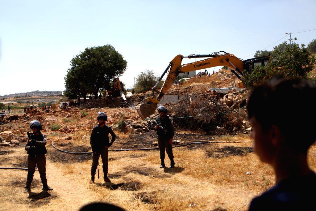 "HEBRON, July 16, 2019 - Israeli bulldozers demolish water wells in ""Area C"" of the West Bank city of Hebron, July 16, 2019. The Israeli army demolished water wells and other facilities used ..."