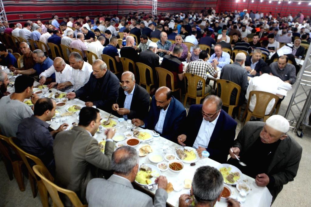 HEBRON, May 23, 2018 - Palestinians break their fast on the sixth day of the holy fasting month of Ramadan in the West Bank City of Hebron, on May 22, 2018.