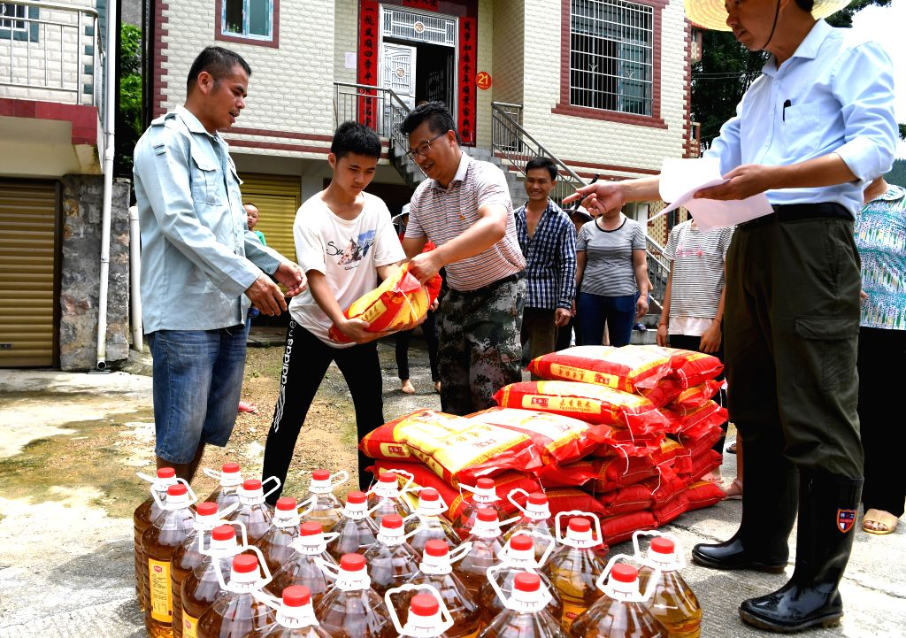 HECHI, July 17, 2019 (Xinhua) -- Villagers receive disaster relief materials in Pola Village of Aidong Township in Donglan County of Hechi, south China's Guangxi Zhuang Autonomous Region, July 16, 2019. (Xinhua/Zhou Hua/IANS)