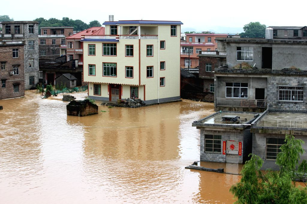 HECHI, May 20, 2016 - Photo taken on May 20, 2016 shows flooded buildings of Mujiang Village of Fuchuan Yao Autonomous County, south China's Guangxi Zhuang Autonomous Region. A flood alert was issued ...