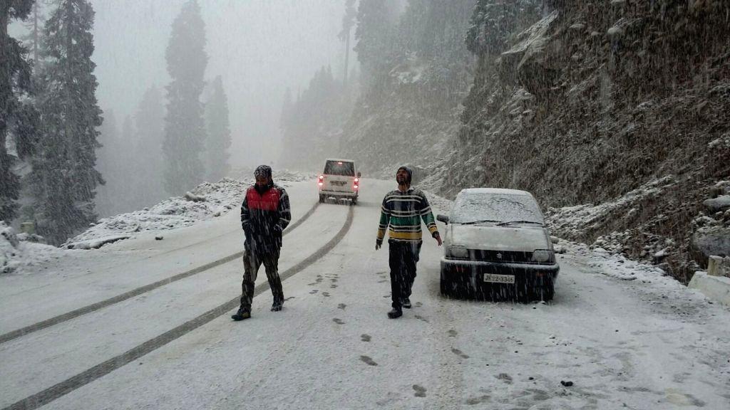 :Heerpora: People enjoy snowfall at Heerpora in Shopian district of Jammu and Kashmir on Nov. 5, 2015. (Photo: IANS).