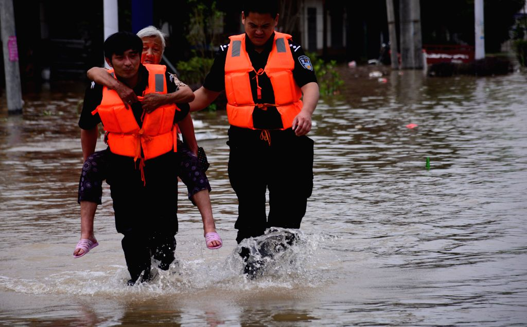HEFEI, July 5, 2016 - Rescuers transfer trapped villagers in flooded Shucheng County, east China's Anhui Province, July 3, 2016. Rainstorm has battered Shucheng County since June 30, ripping a breach ...