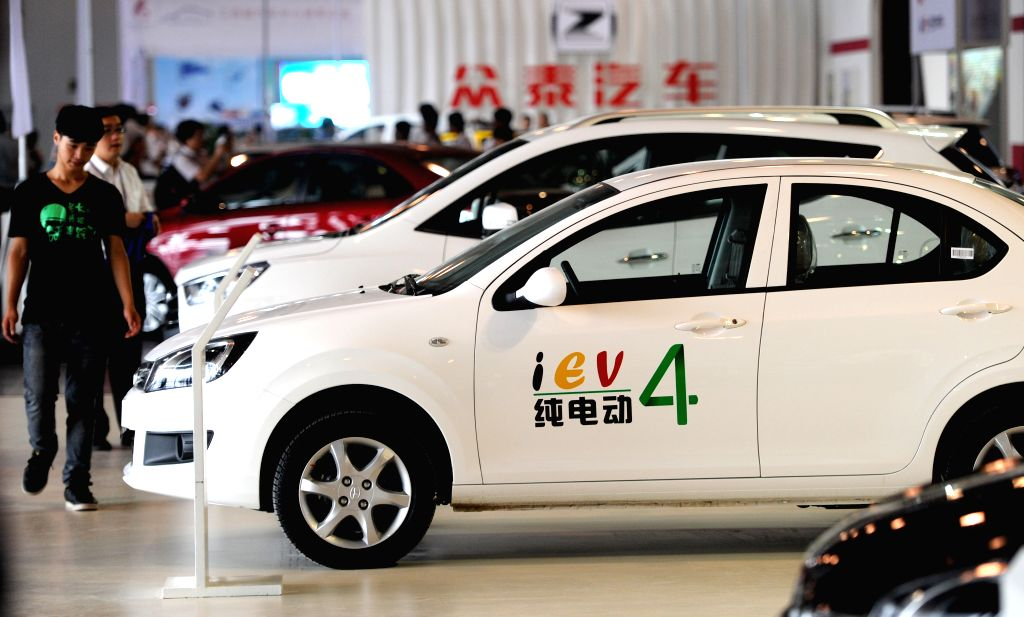 Visitors watch an electric vehicle at the Green Auto China 2014 in Hefei, capital of east China's Anhui Province, Sept. 5, 2014. The three-day Green Auto China 2014, .