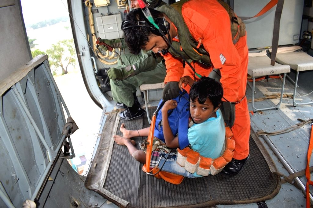 Helicopters of Indian Air Force rescued 31 people from rooftops and brought them to safety to Arambaug