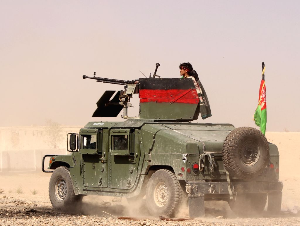 HELMAND (AFGHANISTAN), Oct. 14, 2017 An Afghan security force member stands on a military vehicle during an operation in Nad Ali district of Helmand province, Afghanistan, Oct. 13, 2017. ...