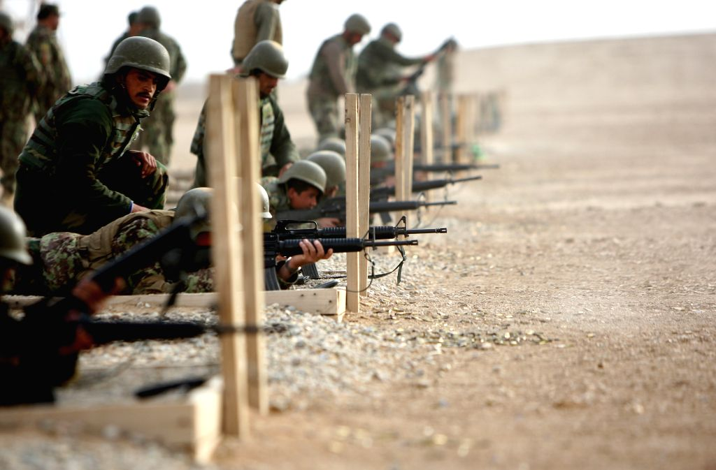 Afghan National Army soldiers take part in their military training at a camp in Helmand, Afghanistan, April 9, 2015.