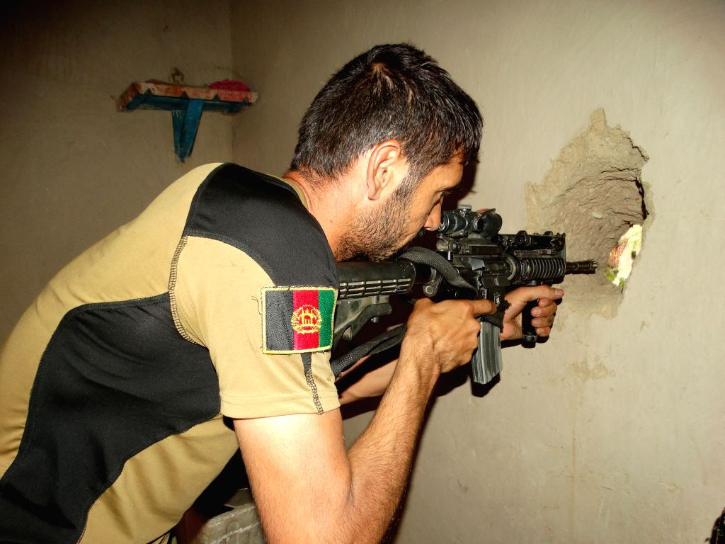 HELMAND, Aug. 15, 2016 - A soldier takes part in a military operation in Chah-e-Anjir district of Helmand province, Afghanistan, Aug. 14, 2016. Up to 25 militants were killed as warplanes targeted ...