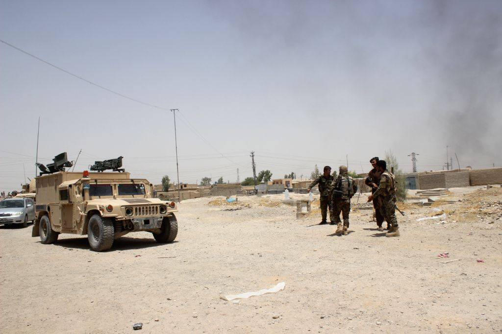 HELMAND, Aug. 4, 2017 - Afghan security forces members inspect at the clash site in Gereshk district of southern Afghan province of Helmand, on Aug. 4, 2017. Over 40 Taliban insurgents and four ...