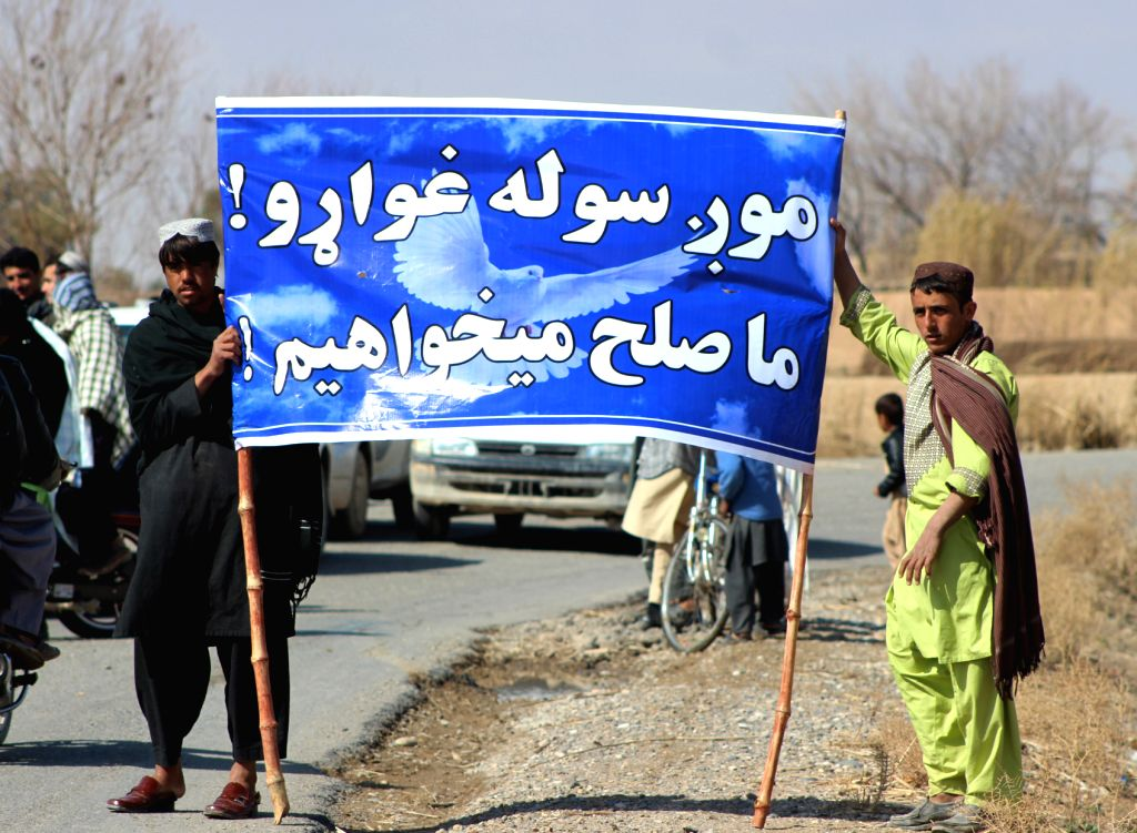 HELMAND, Feb. 19, 2019 - Afghans take part in a demonstration calling for peace in Nad Ali district of Helmand province, Afghanistan, Feb. 18, 2019. Hundreds of Afghan people in the restive Nad Ali ...