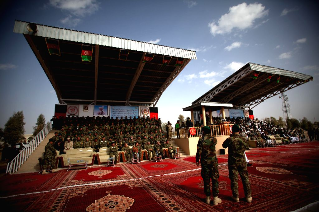 Afghan army commanders attend a ceremony marking the end of security transition from NATO-led troops to Afghan army in Gereshk district in the southern Helmand ...