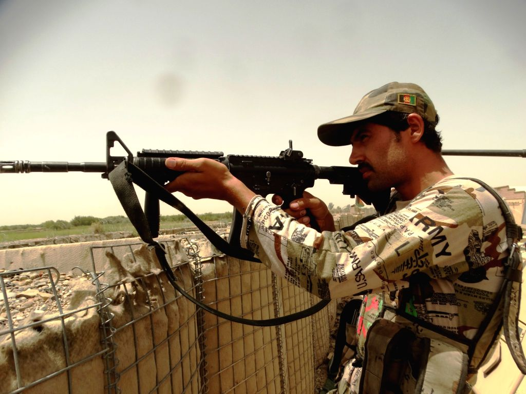 HELMAND, July 18, 2016 - A soldier takes position during a military operation in Nad Ali district of Helmand province, Afghanistan, July 18, 2016. Afghan security forces have obviously adopted an ...