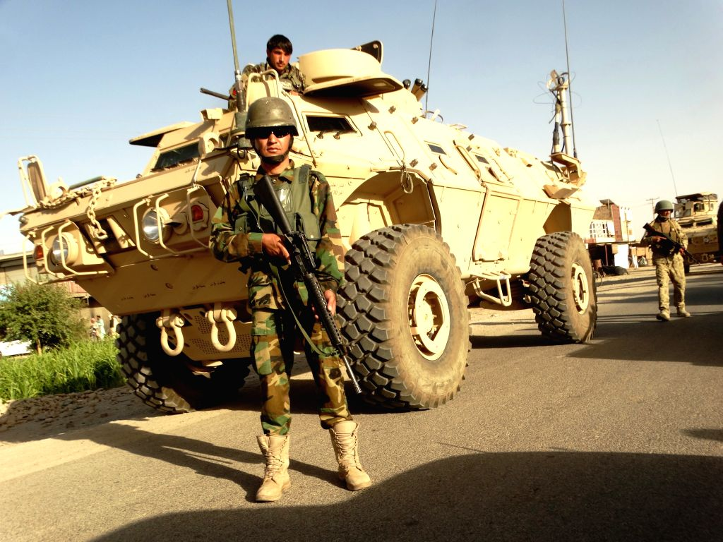 HELMAND, July 24, 2016 - A member of Afghan security forces stands guard near a military vehicle during a military operation in Sangin district of southern Helmand province, Afghanistan, on July 23, ...