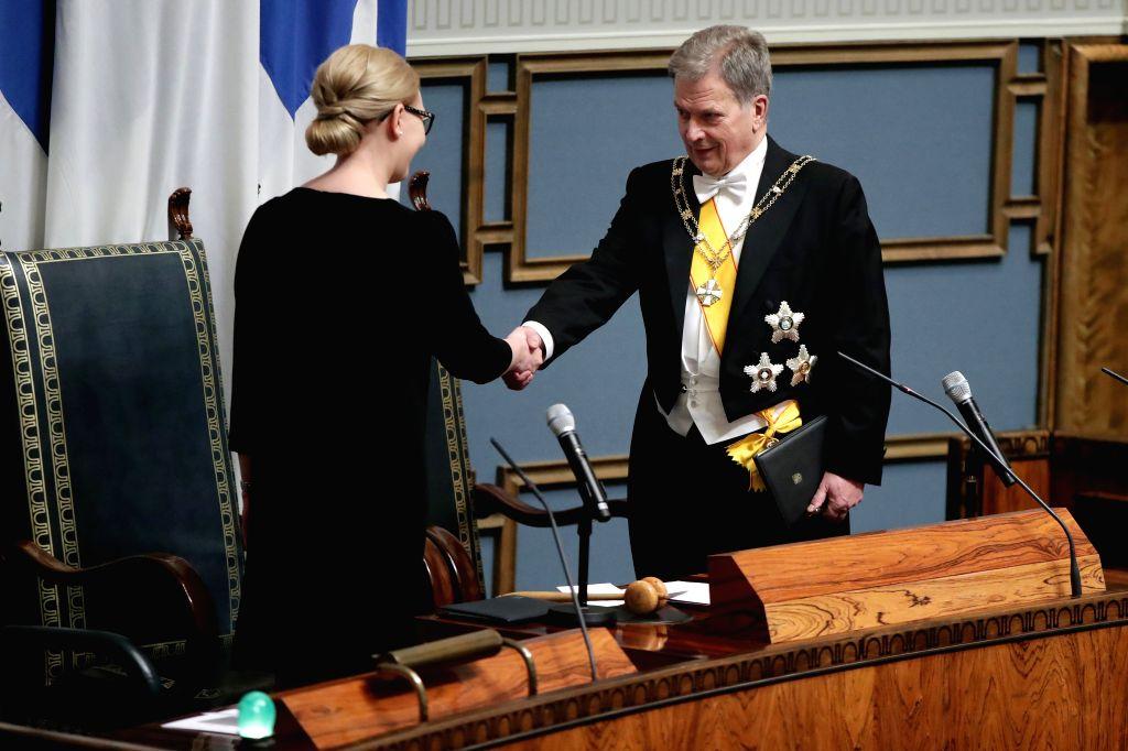 HELSINKI, Feb. 2, 2018 - Finnish President Sauli Niinisto (R) shakes hands with Speaker of Parliament Maria Lohela during the inauguration of the president in the Finnish parliament in Helsinki, ...