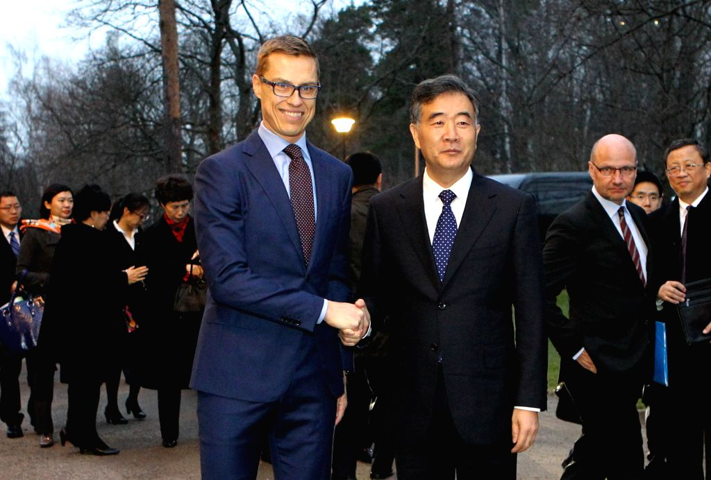 Helsinki (Finland): Chinese Vice Premier Wang Yang (R) shakes hands with Finnish Prime Minister Alexander Stubb in Helsinki, Finland, on Nov. 18, 2014. - Alexander Stubb