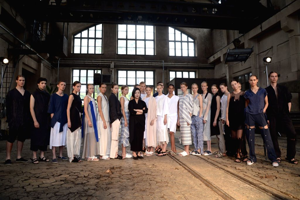 HELSINKI, July 23, 2016 - South Korean Designer Sujinn Kim(C) poses with models during the Helsinki Fashion Week in Helsinki, Finland, on July 22, 2016. The first two fashion shows of the Helsinki ...