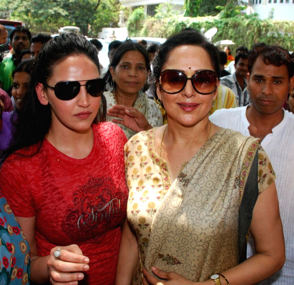 Hema Malini with her daughter Isha Deol after casting their votes in Mumbai.