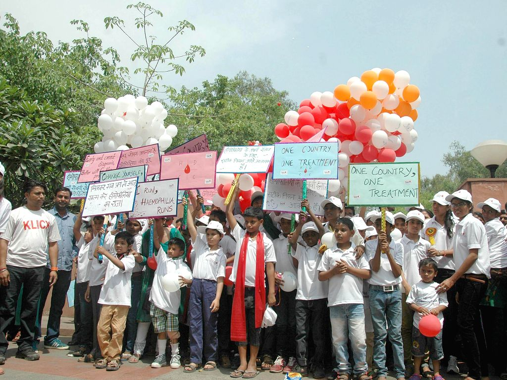 Hemophilia patients participate in an awareness walk from Rajghat to LNJP Hospital to launch the initiative 'One Country one Treatment for Hemophilia' in New Delhi on April 15, 2014.