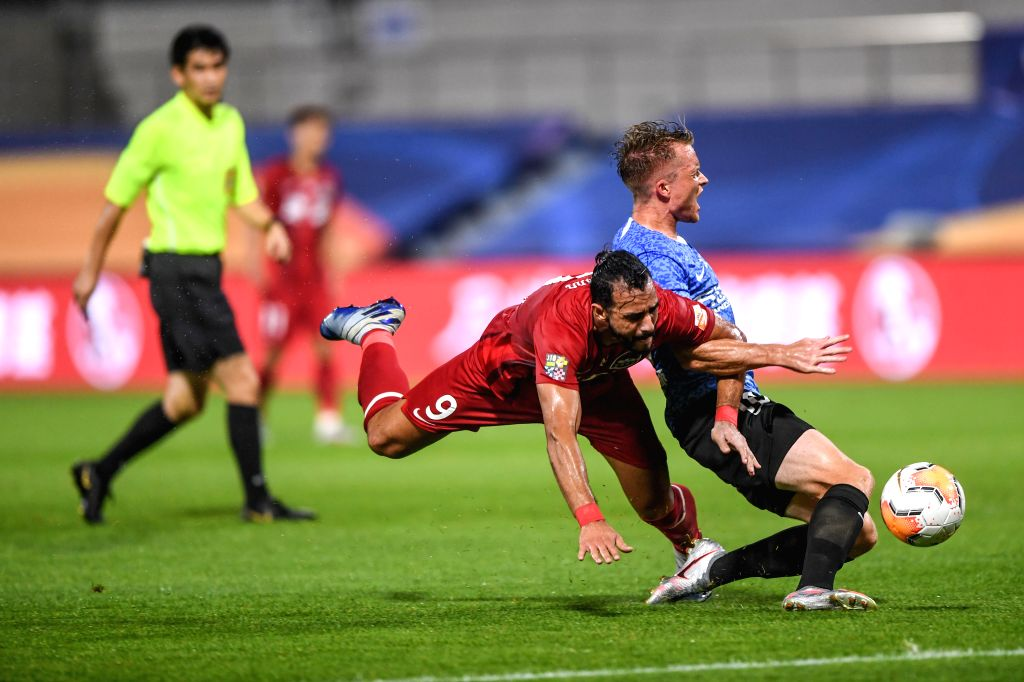 Henrique Dourado (L) of Henan Jianye FC vies with Sam Larsson of Dalian Yifang FC during the second round match between Dalian Yifang FC and Henan Jianye FC at the ...