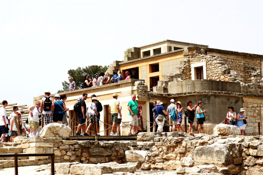 HERAKLION (GREECE), May 23, 2018 People visit the Palace of Knossos in Heraklion, Greece, on May 23, 2018. Knossos is an archaeological site in Crete where the Minoan civilization ...