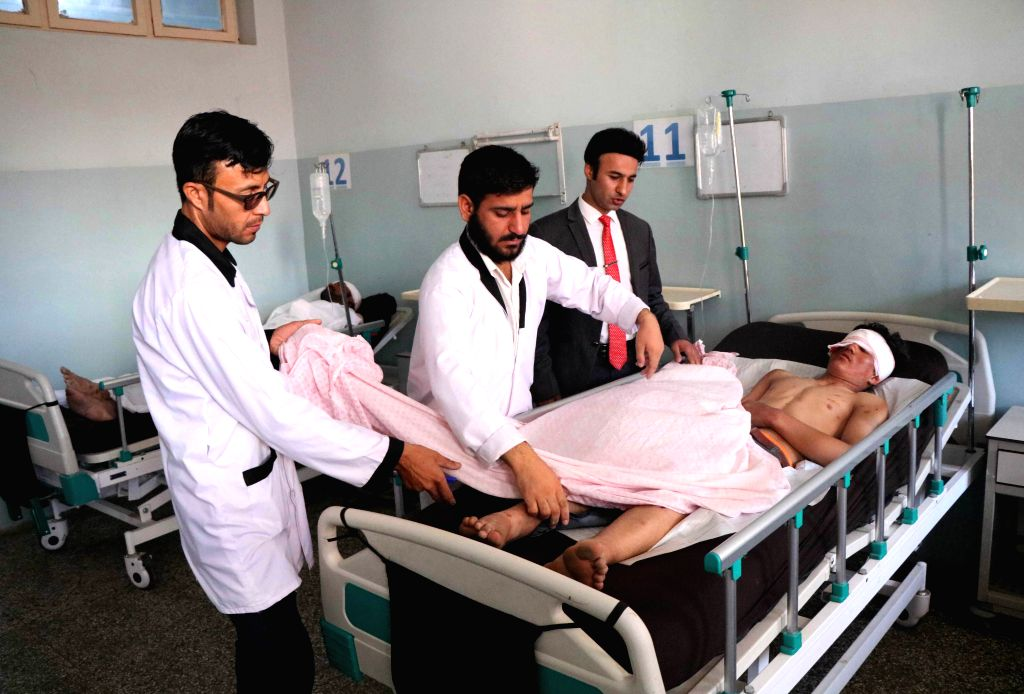 HERAT, July 31, 2018 - An injured man receives medical treatment at a hospital in Herat province, western Afghanistan, July 31, 2018. At least eight people were killed and 40 others wounded as a ...