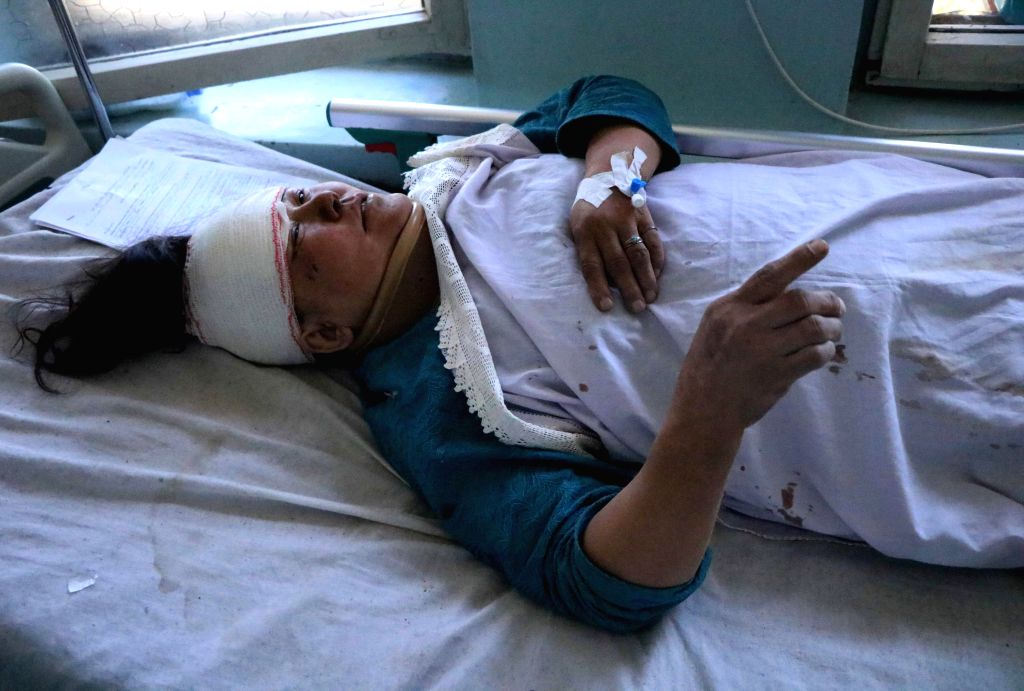 HERAT, July 31, 2018 - An injured woman receives medical treatment at a hospital in Herat province, western Afghanistan, July 31, 2018. At least eight people were killed and 40 others wounded as a ...
