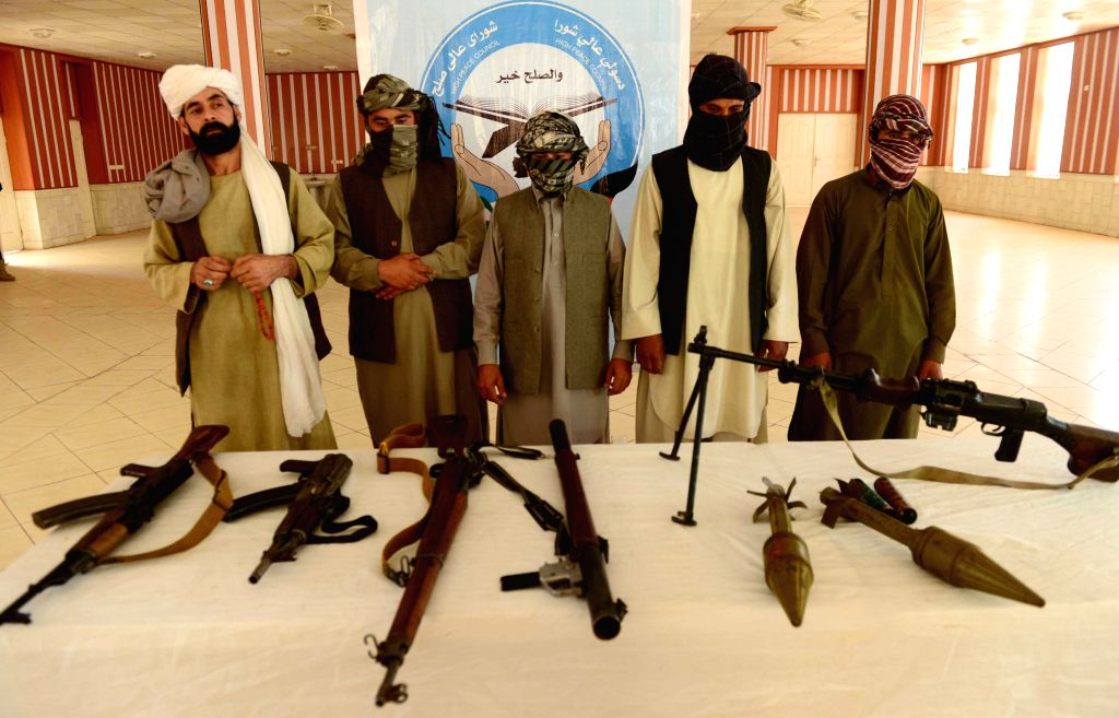 Taliban fighters attend a surrender ceremony in Herat Province, western Afghanistan, June 17, 2015. A total of eight militants gave up fighting and handed over their ...