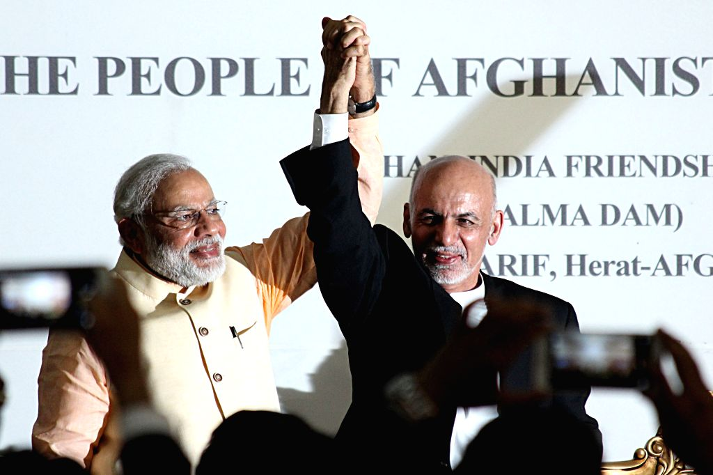 HERAT, June 4, 2016 - Afghan President Mohammad Ashraf Ghani (R) joins hands with Indian Prime Minister Narendra Modi during the inauguration ceremony of an India-funded hydropower dam in Herat ... - Narendra Modi