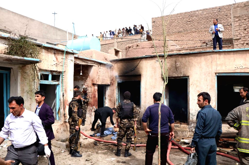 HERAT, March 25, 2018 - Afghan security force members inspect at the site of an attack in Herat province, Afghanistan, March 25, 2018. One Afghan civilian and two assailants were killed and seven ...
