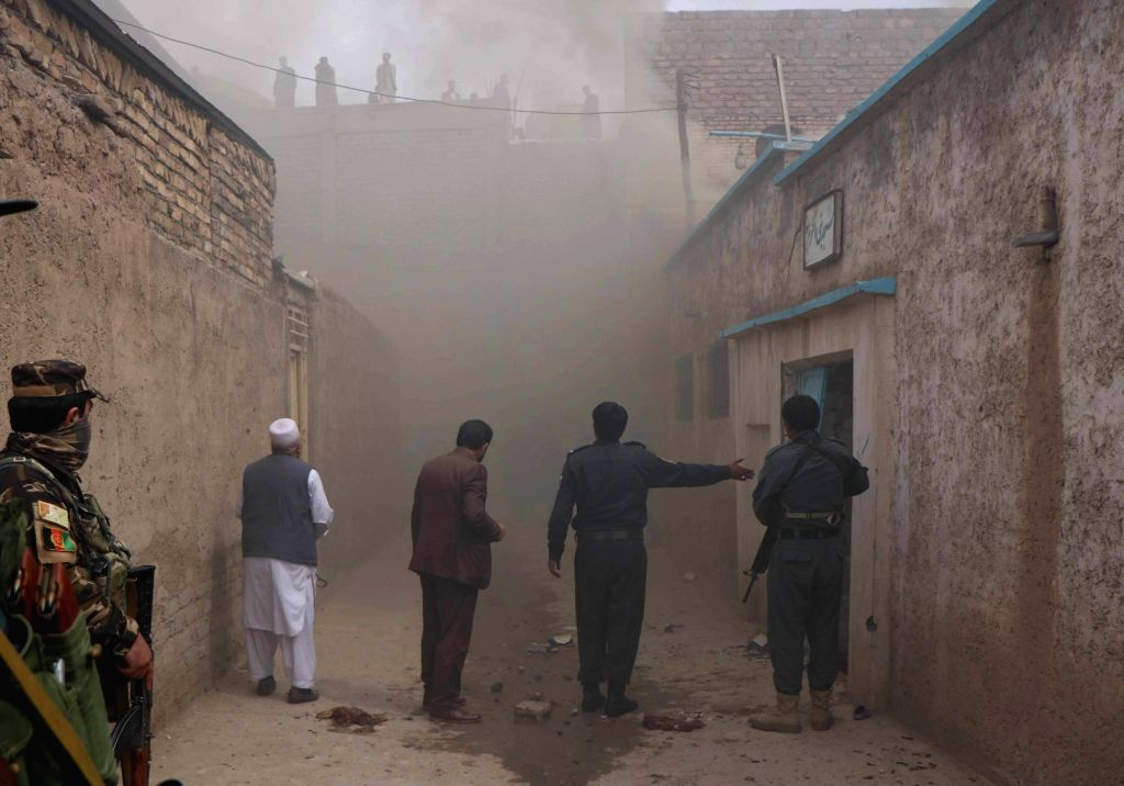 HERAT, March 25, 2018 - Afghan security force members arrive at the site of an attack in Herat province, Afghanistan, March 25, 2018. One Afghan civilian and two assailants were killed and seven ...