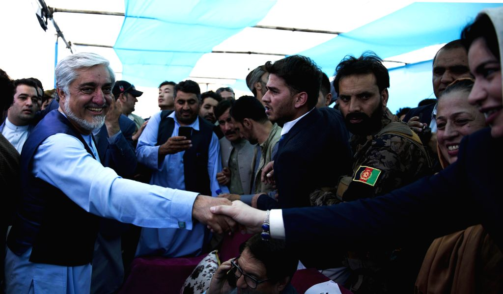HERAT, Sept. 24, 2019 - Afghan presidential candidate Abdullah Abdullah shakes hands with his supporter during an election campaign in Herat province, western Afghanistan, Sept. 24, 2019. The country ...
