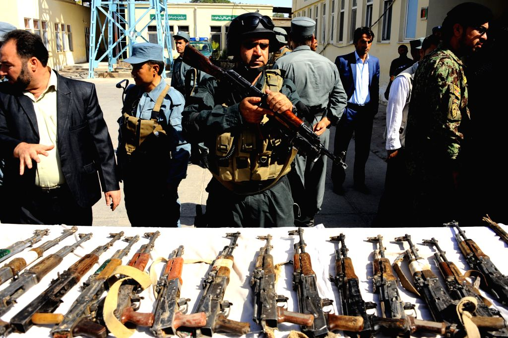 Afghan security forces display weapons captured from Taliban militants in Herat Province, western Afghanistan, on Sept. 7, 2014.