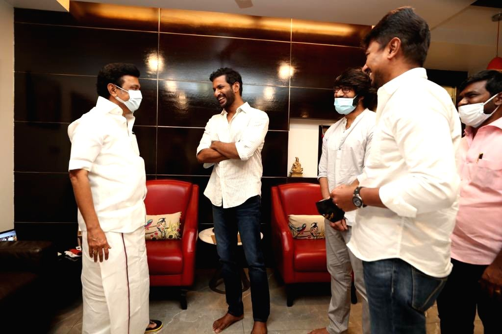 Hero Vishal accompanied by his friend Ramana met Tamil Nadu Chief Minister Elect DMK Chief MK Stalin and his son MLA Elect Udayanidhi Stalin and congratulated them for presenting a shawl  ... - Elect D