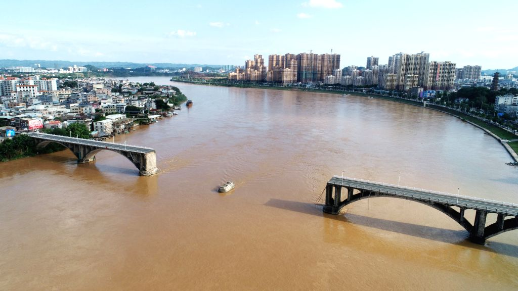 HEYUAN, June 14, 2019 - Aerial photo taken on June 14, 2019 shows the collapsed Dongjiang Bridge in Heyuan, south China's Guangdong Province. Two people are reported missing and one rescued after two ...