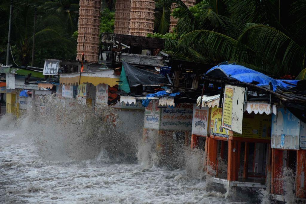High tides lash the shore at the Dadar Beach in Mumbai on July 5, 2020.