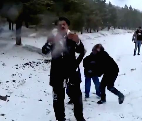 Hilarious!: Weatherman pelted with snowballs.
