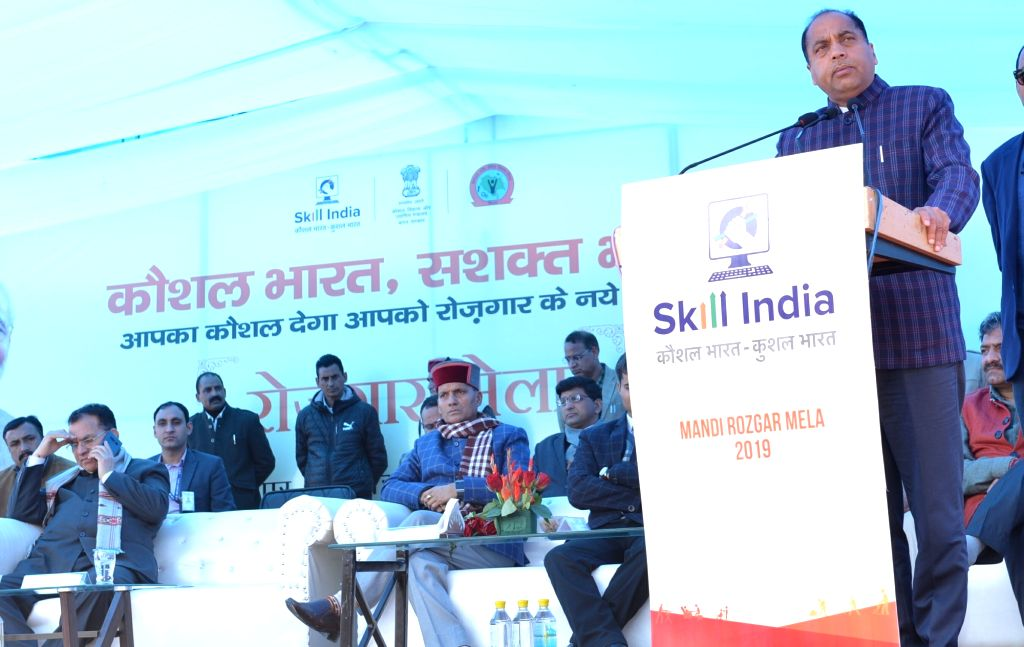 Himachal Chief Minister Jai Ram Thakur addresses at the inauguration of the Rozgar Mela in Himachal Pradesh's Mandi, on Feb 22, 2019. Also seen BJP MP Ram Swaroop Sharma. - Jai Ram Thakur and Swaroop Sharma