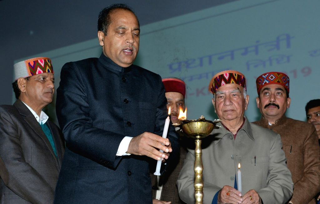 Himachal Chief Minister Jai Ram Thakur lights the lamp to inaugurate the Pradhan Mantri Kisan Samman Nidhi (PM-KISAN) scheme in Dharamshala, on Feb 24, 2019. - Jai Ram Thakur