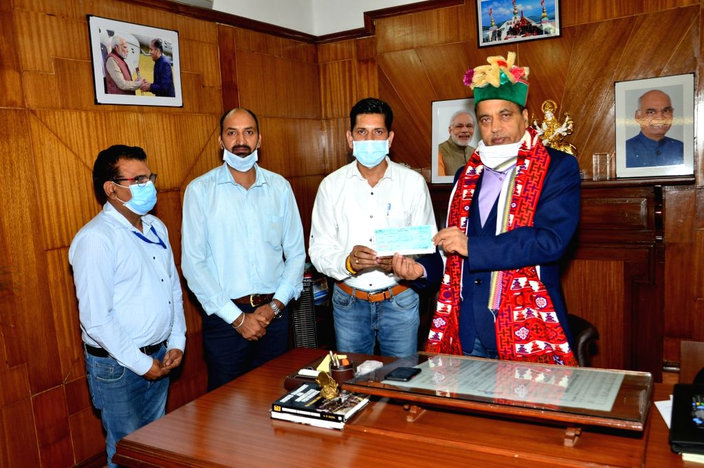 Himachal Chief Minister Jai Ram Thakur was today presented a cheque of Rs. 51 thousand by Manohar Lal, President of Mandi District Ministerial Staff Association of Health and Family Welfare ... - Jai Ram Thakur