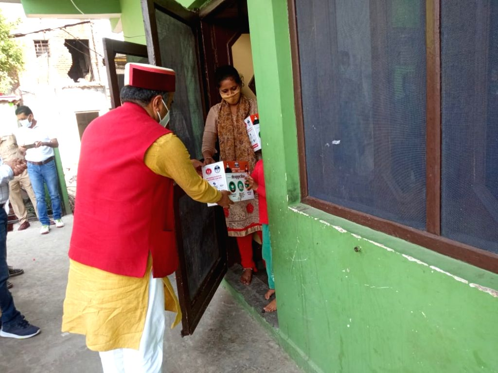 Himachal Health Minister visits patients to provide isolation kits.