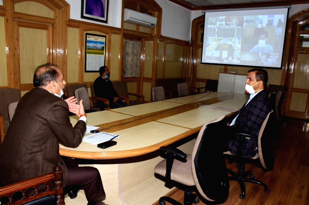 Himachal Pradesh Chief Minister Jai Ram Thakur interacts with Union Health Minister Harsh Vardhan during a meeting chaired by the latter through video conferencing to review the steps being ... - Jai Ram Thakur