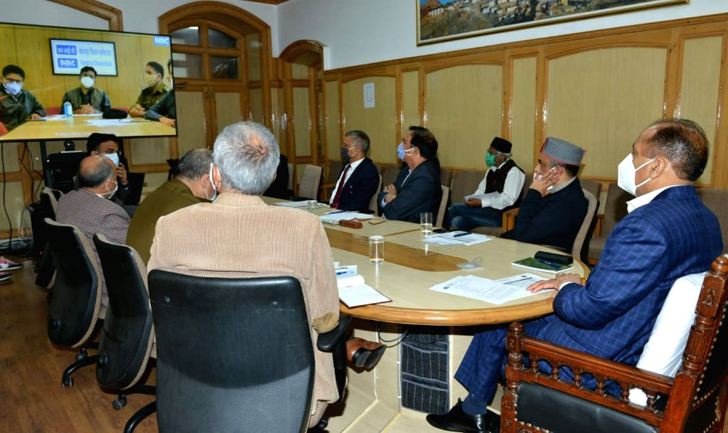 Himachal Pradesh Chief Minister Jai Ram Thakur chairs a video conference meeting with the state's Deputy Commissioners, Superintendents of Police, Chief Medical Officers, Principals of ... - Jai Ram Thakur
