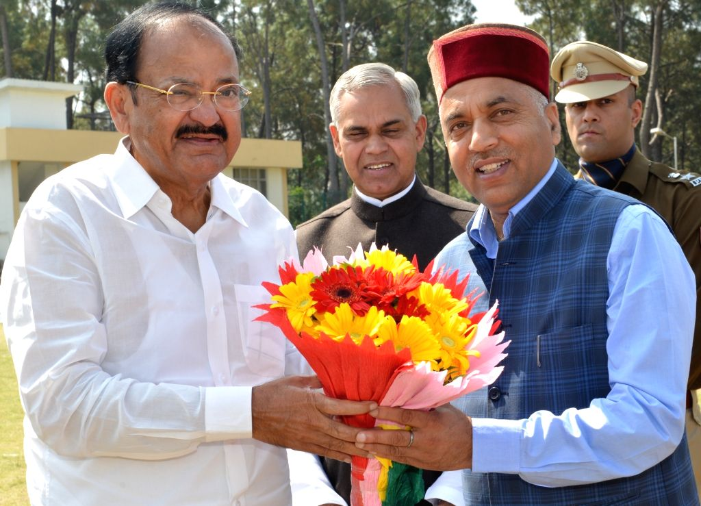 Himachal Pradesh Chief Minister Jai Ram Thakur receives Vice President Venkaiah Naidu on his arrival in Hamirpur on April 7, 2018. - Jai Ram Thakur and Venkaiah Naidu