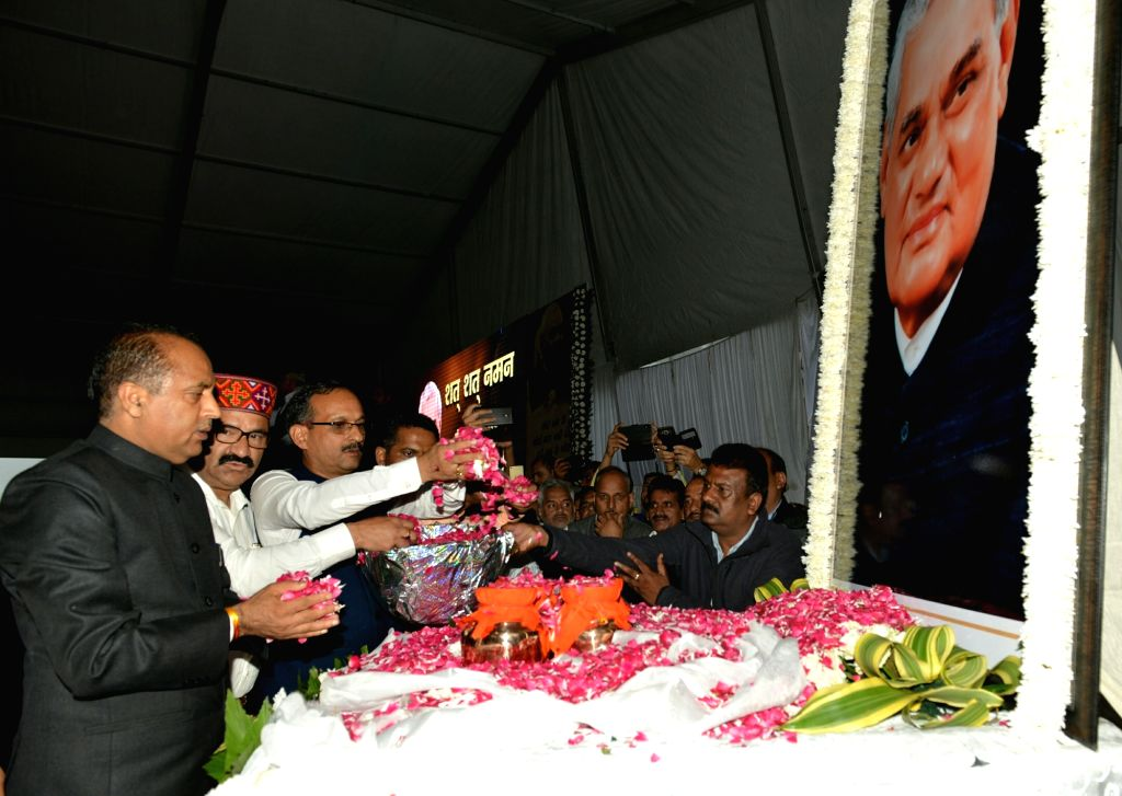 Himachal Pradesh Chief Minister Jai Ram Thakur pays tribute during a prayer meeting organised in the memory of former Prime Minister Late Atal Bihari Vajpayee, in Shimla, on  Aug 22, 2018. - Jai Ram Thakur and Atal Bihari Vajpayee